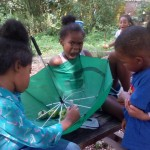 Kids Stop by Community Garden